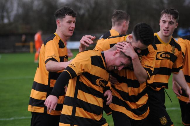 Juniors- Kilbirnie Ladeside v Petershill,.Valefield Park, Kirkland Road, Kilbirnie...Picture shows Kilbirnie's Jon Scullion celebrating his goal with teammates..Kirsty Anderson Newsquest / Herald and Times ..10/11/18.