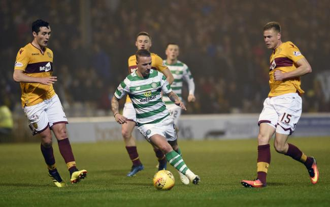 Celtic's Leigh Griffiths goes past Motherwell's Carl McHugh and Andy Rose during the Ladbrokes Scottish Premiership match at Fir Park, Motherwell, on Wednesday December 5, 2018