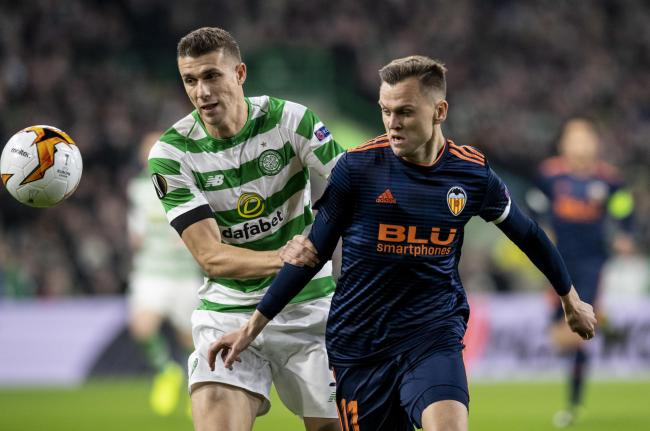 Jozo Simunovic, left, in action for Celtic against Valencia last year.