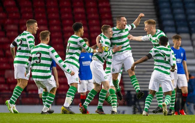 Celtic's players celebrate after Paul Kennedy's deflected effort pulls them level