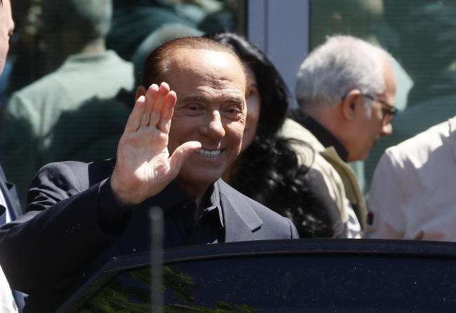 Former Italian Premier Silvio Berlusconi waves as he leaves the San Raffaele hospital   AP Photo/Antonio Calanni