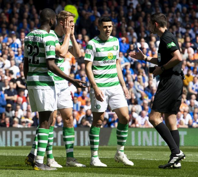 The Celtic players can't believe referee Kevin Clancy only booked Rangers player Jon Flanagan for elbowing Scott Brown.
