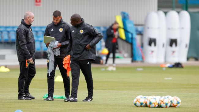 Scotland manager Steve Clarke, left,  and coaches Steven Reid, centre, and Alex Dyer, right, formulate their game plan during training.