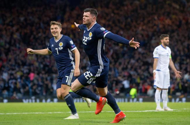 Oliver Burke scored a last-minute winner for Scotland against Cyprus.